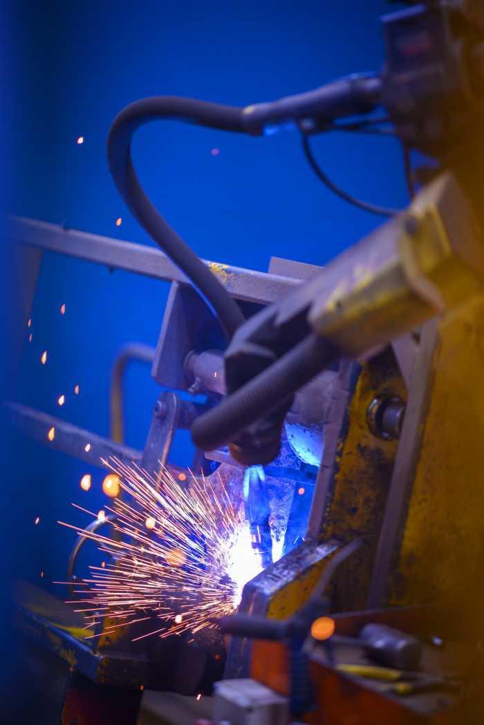 Robotic welder in process
